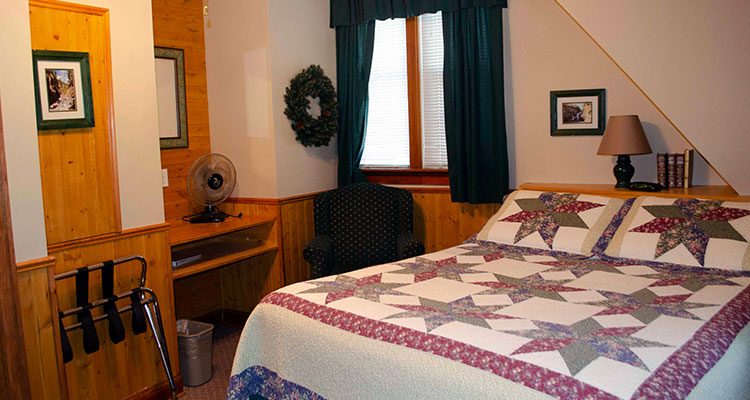 One queen bed suite at Crandell Mountain Lodge