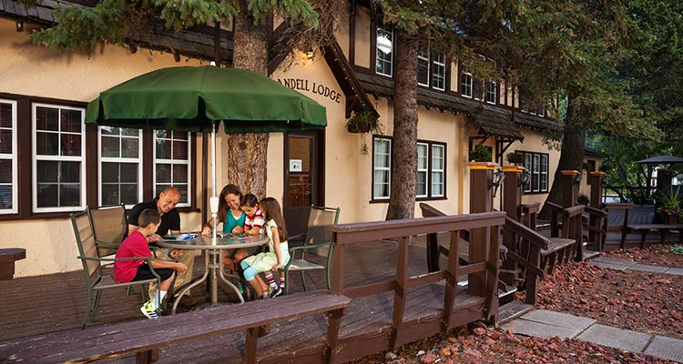 An image of a family enjoying an evening on Crandell's patio